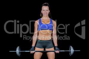Portrait of cheerful woman lifting crossfit