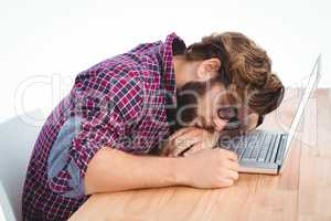Hipster resting with head on laptop