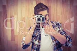 Hipster showing thumbs up while photographing