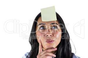 Woman thinking with a post it on her head