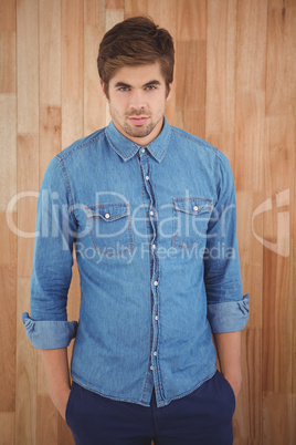 Portrait of confident hipster with hands in pockets