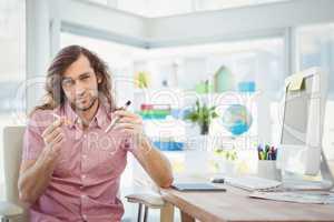 Portrait of hipster holding cigarettes