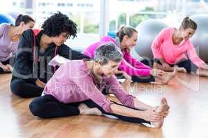 Fit women exercising on hardwood floor
