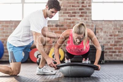 Trainer motivating client doing push ups