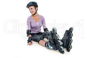 Sporty woman wearing inline skates relaxing