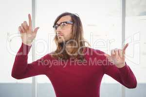 Creative businessman gesturing in office