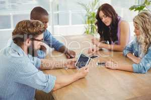 Business professionals using technology at desk