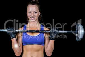 Portrait of happy woman lifting crossfit