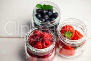 Glass jars of fresh berries