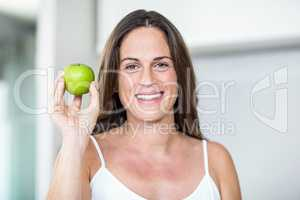 Portrait of woman with Granny Smith
