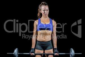 Portrait of woman exercising with crossfit