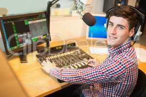 Radio host operating sound mixer