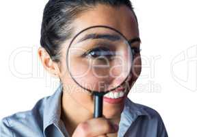 Woman examining with a magnifying glass