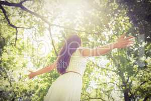 Low angle view of long hair woman with arms outstretched