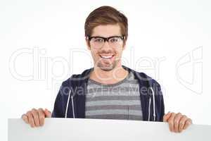 Portrait of man wearing eye glasses holding billboard