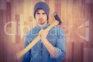 Portrait of confident hipster holding axe on shoulder