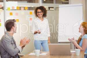 Colleagues appreciating businesswoman in meeting