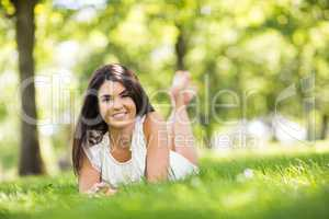 Portrait of beautiful woman lying on grassland