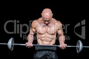 Bodybuilder exercising with crossfit