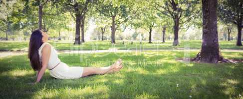 Young woman relaxing on grassland