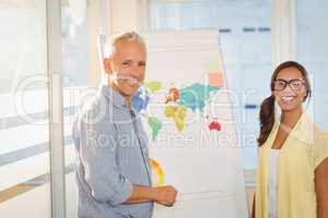Happy business people with world map in meeting room
