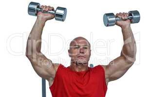 Athlete lifting dumbbells