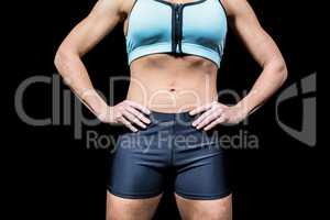 Midsection of powerful woman with hands on hip