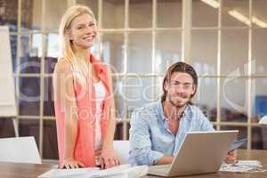 Stylish business people using technologies