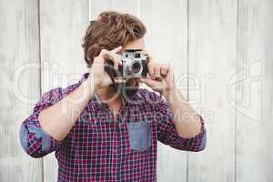 Hipster photographing with camera