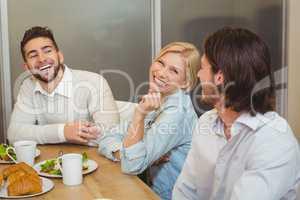 Business people enjoying brunch in canteen