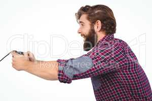 Side view of happy hipster playing video game