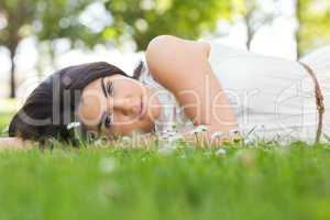 Portrait of beautiful woman relaxing on grassland