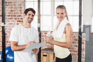 Muscular woman watching her results on clipboard