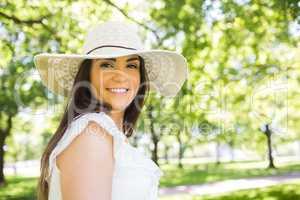 Portrait of happy woman in hat