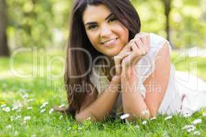 Portrait of pretty woman lying on grassland
