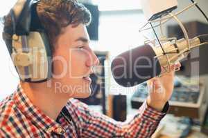 Young radio host broadcasting in studio