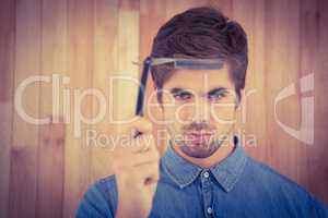 Portrait of serious hipster holding straight edge razor