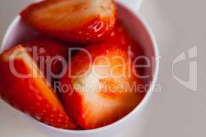 Portion cup of sliced strawberry
