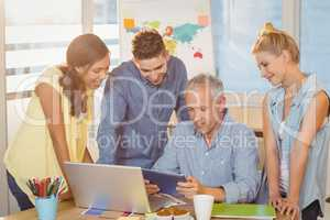 Business people using technologies in meeting room