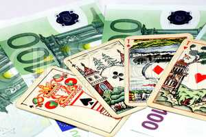 euros banknote with playing card