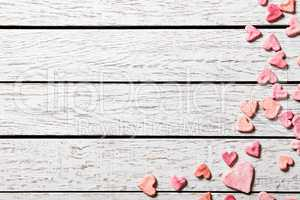 Holiday background with heap of small hearts