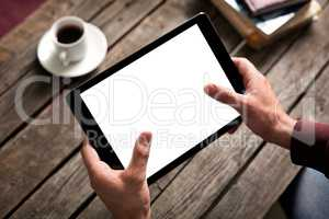 Tablet computer with isolated screen in male hands