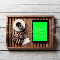 Gift box with blank tag, cup of coffee and tablet
