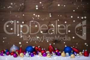 Colorful Christmas Balls As Decoration On Snow, Snowflakes