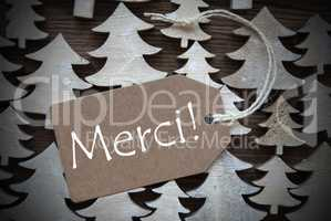 Brown Christmas Label With Merci Means Thank You
