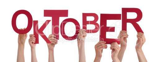 People Holding German Word Oktober Means October