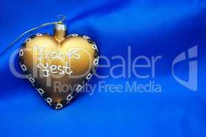 Goldenes Herz - Frohes Fest - vor blauem Stoff