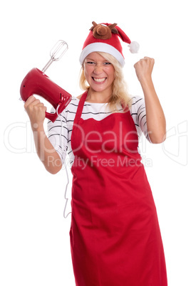 Weihnachtsfrau mit Handmixer ballt eine Faust