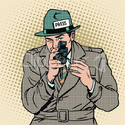 Journalist takes on retro camera. Paparazzi snooping tabloid press