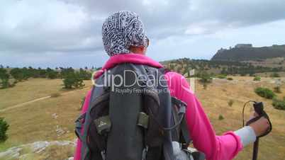 Crane shot of woman hiker enjoy view at plateau mountain peak
